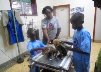 Tendo-and-Ndhego-holding-baby-cheetahs-at-UWEC (1)