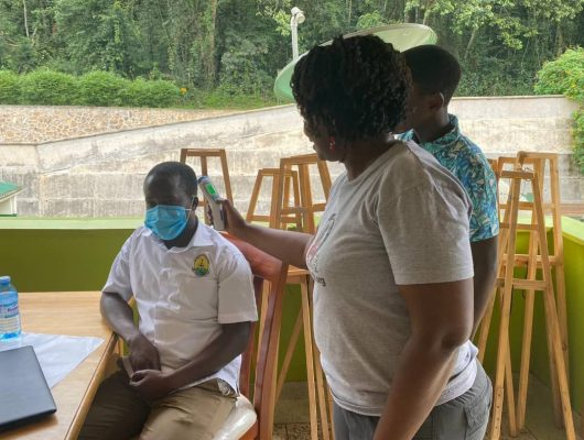 Dr Gladys demonstrating how to use a thermometer during training of park staff on COVID-19-Photo by CTPH